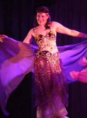 "Nadia's interest into bellydancing began in 2004 when she fell in love with a dance costume in a bazaar...which she just had to have!  After attending a class of Krystina's, she was hooked.    ""I was astounded by the beauty in flow of movement and amazing isolations.""  Nadia has been learning with Krystina ever since.  Nadia is also inspired by Yasmina and has attended a couple of her workshops."